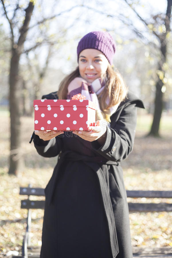 Download Young Woman With A Gift In Their Hands Stock Image - Image: 83724851