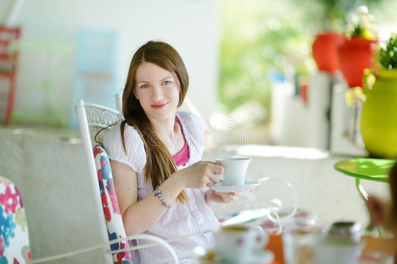 Young woman girl drinking hot chocolate stock photos