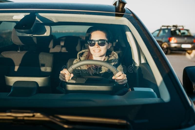 Young woman or girl driver inside the car. royalty free stock photography