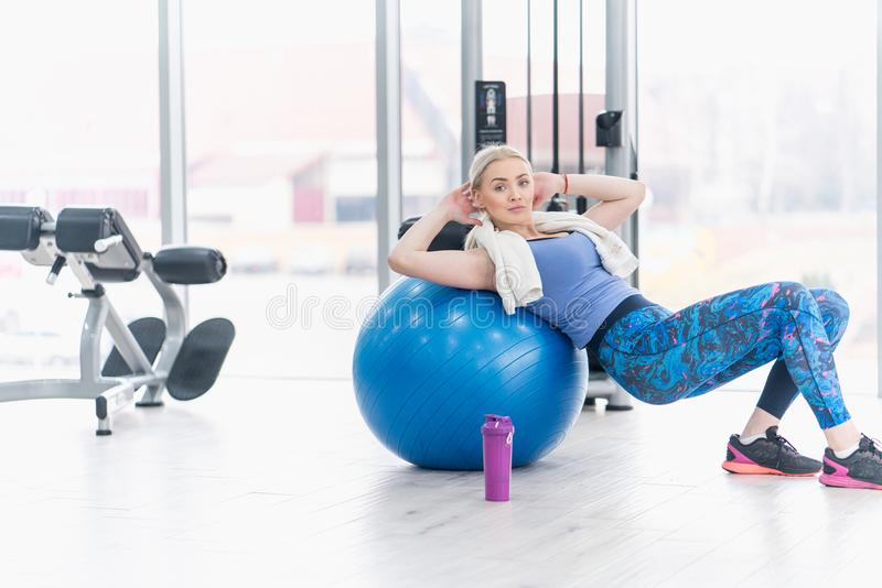 Young woman girl exercise workout in the gym using ball royalty free stock photos