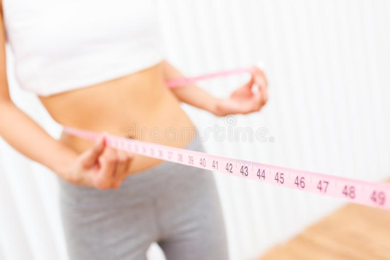 Woman Female Girl Measuring Waist With Tape Measure stock photos