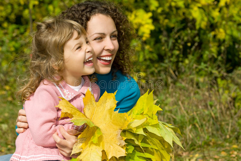 Download Young Woman And Girl Laugh With Leaves In Garden Stock Photo - Image: 11603624