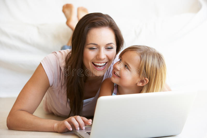 Download Young Woman With Girl Using Laptop Computer Stock Photo - Image of internet, woman: 17068254