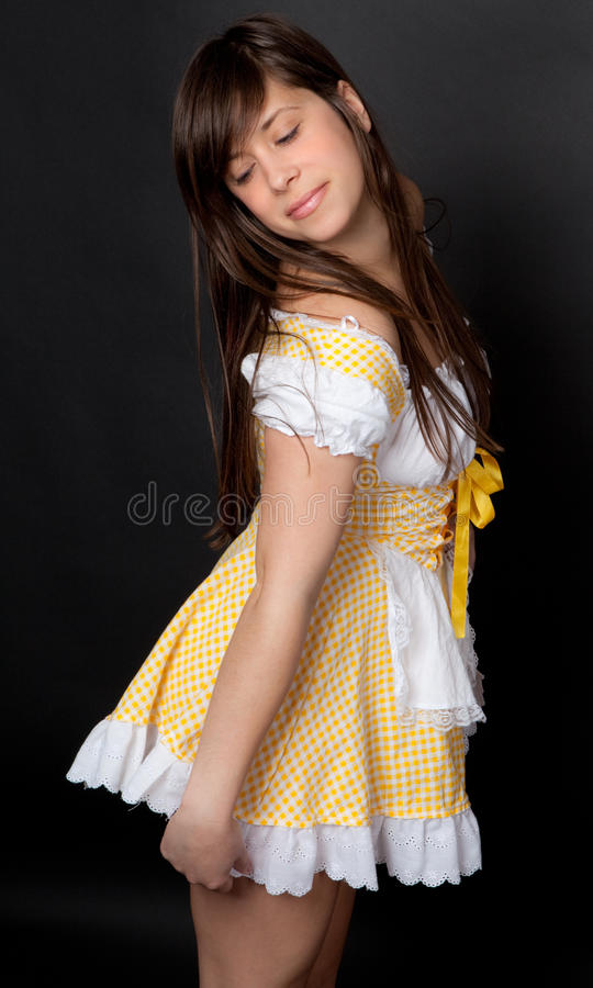 Young Woman in Girlish Dress stock photo