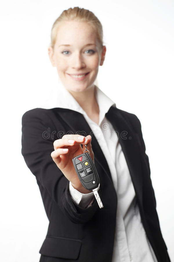 Download Young woman giving car key stock photo. Image of female - 31189250