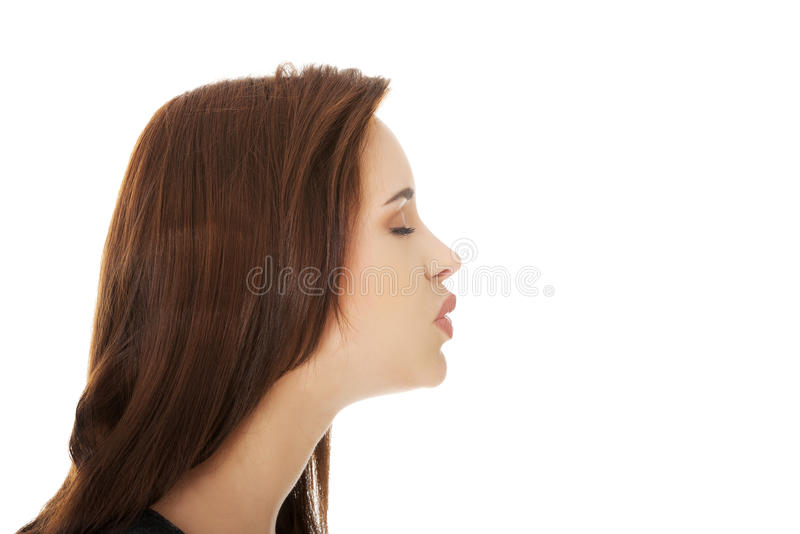Young woman giving kiss stock photo