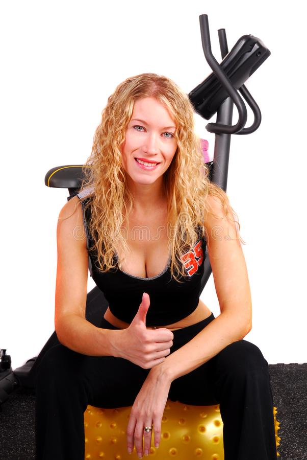 Young woman giving thumbs up after workout stock image