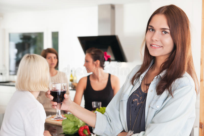 Young woman with a glass of wine stock images