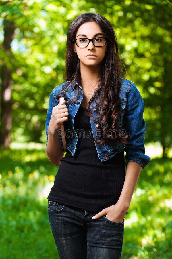 Free Young Woman Glasses Book Underarm Stock Images - 21488724