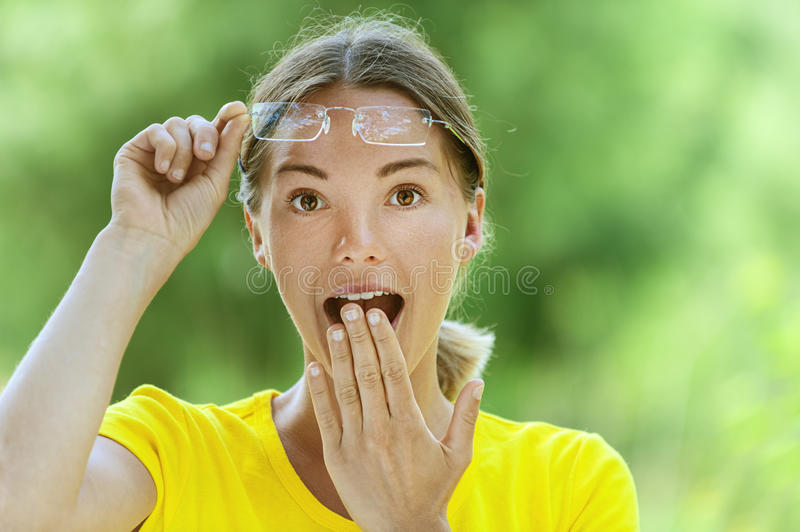 Download Young Woman In Glasses Is Surprised Royalty Free Stock Image - Image: 26316926