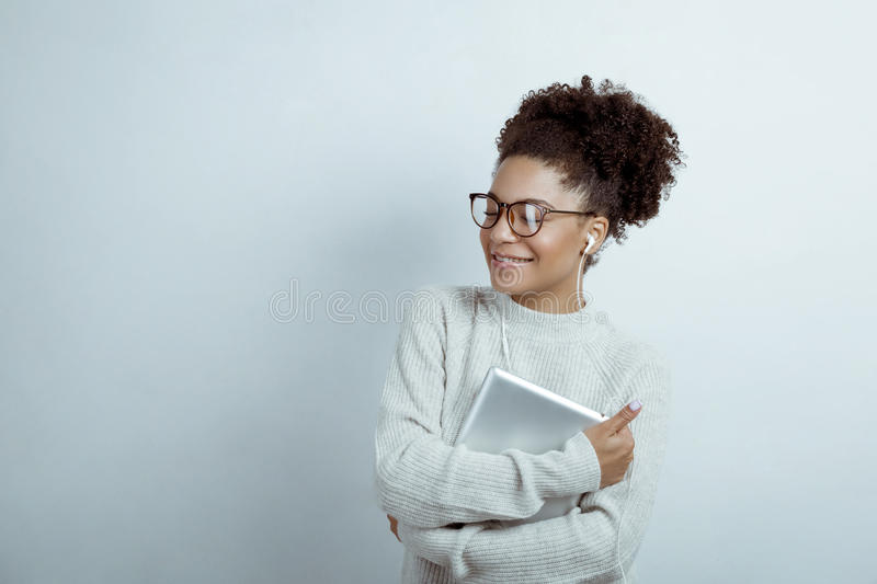 Young woman in glasses wearing headphones royalty free stock image