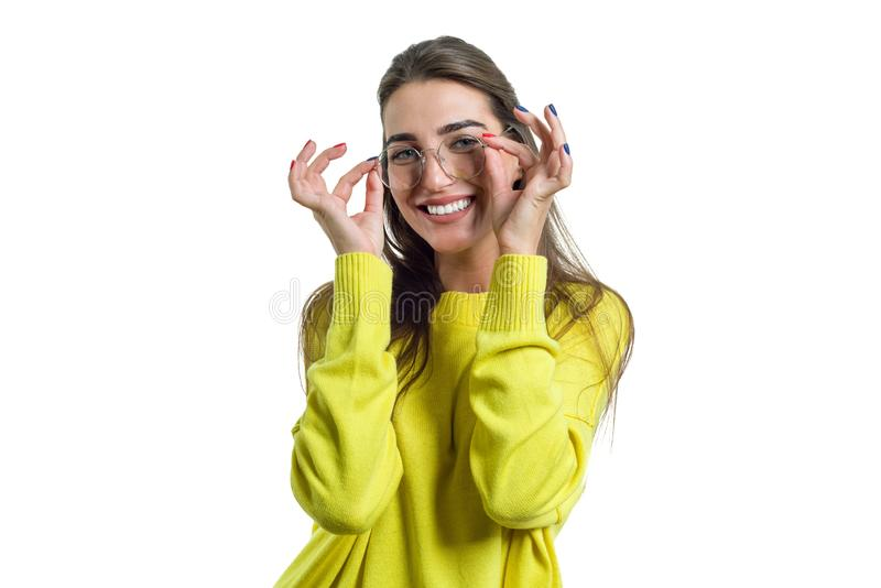 Young woman in glasses yellow clothes on white isolated background stock photos