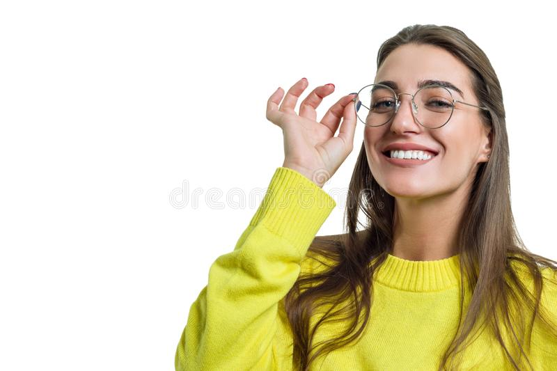 Young woman in glasses yellow clothes on white isolated background royalty free stock image