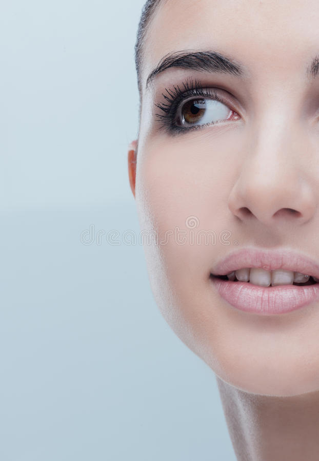Young woman with glowing face skin. Young beautiful woman close-up portrait with perfect glowing face skin royalty free stock photography