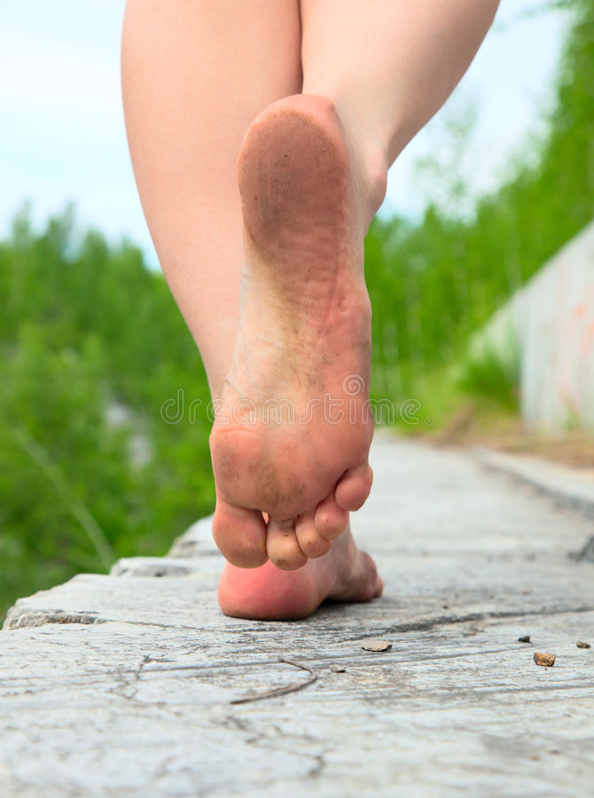 A young woman goes barefoot royalty free stock photography
