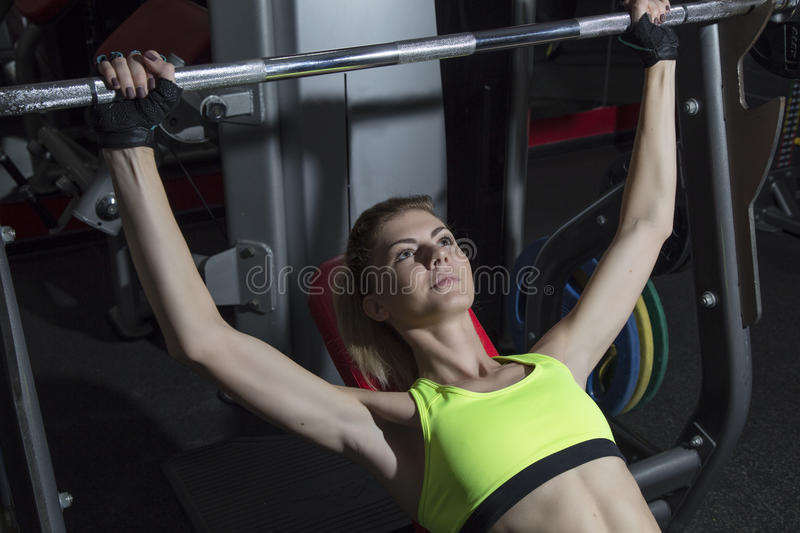 Young woman goes in for sports at gym royalty free stock photos