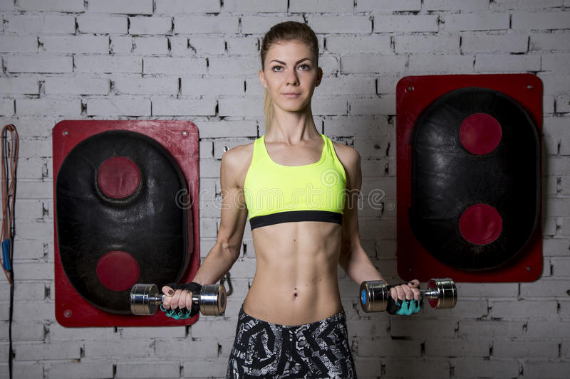 Young woman goes in for sports at gym stock photography