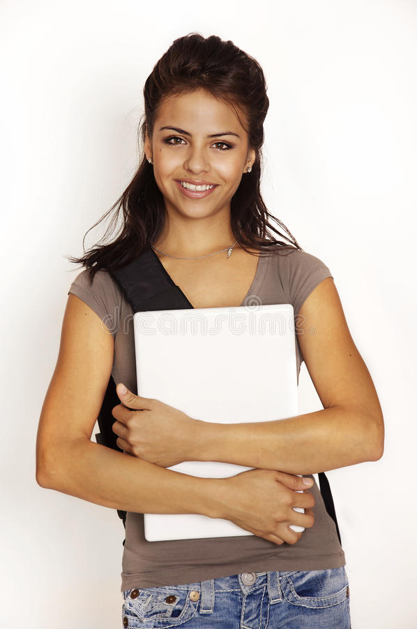 Young woman going back to school. Photo of attractive smiling positive young woman going to school with backpack and laptop computer stock images
