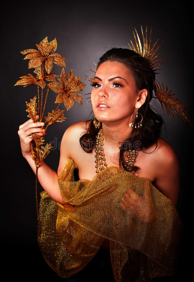 Download Young Woman With Gold Flower On Grey Background. Stock Photo - Image: 12577746