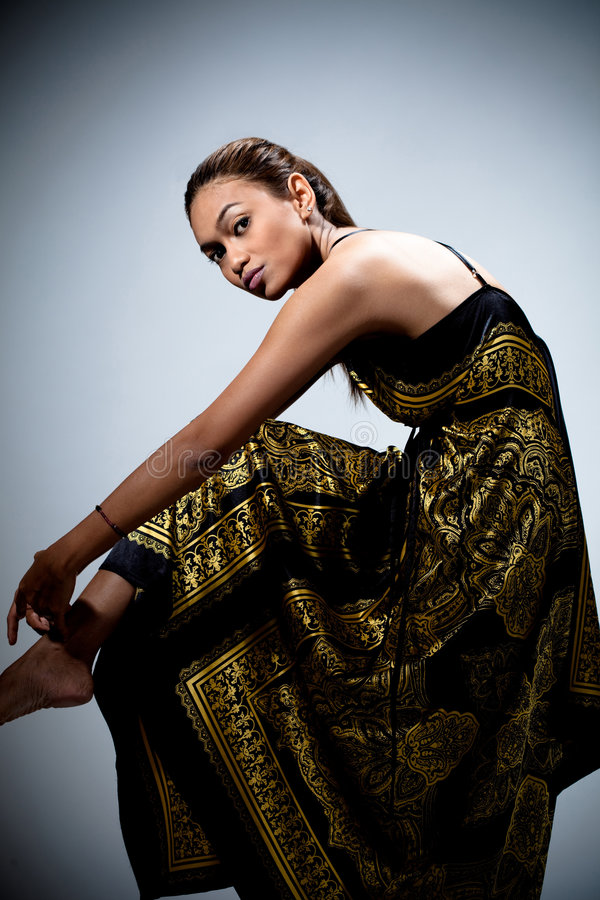 Download Young Woman In Golden Floral Dress Stock Photo - Image: 8584100