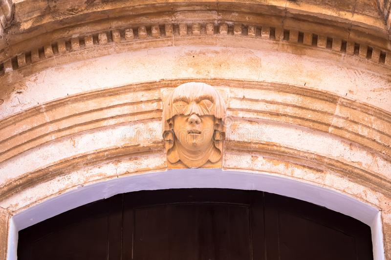 Young Woman Gothic Portrait. Gothic detail. Young woman portrait at the entrance of a 200 years old building in Ciutadella town, Menorca Spain royalty free stock photos