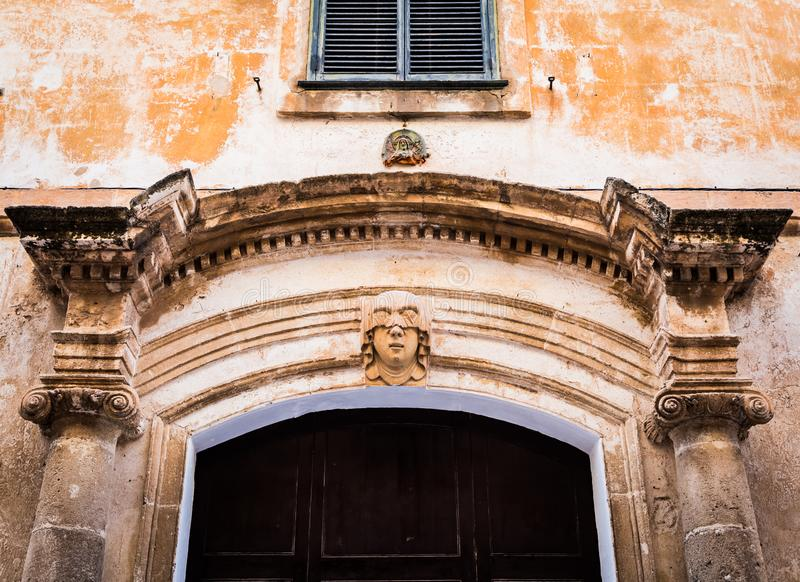 Young Woman Gothic Portrait. Gothic detail. Young woman portrait at the entrance of a 200 years old building in Ciutadella town, Menorca Spain stock image