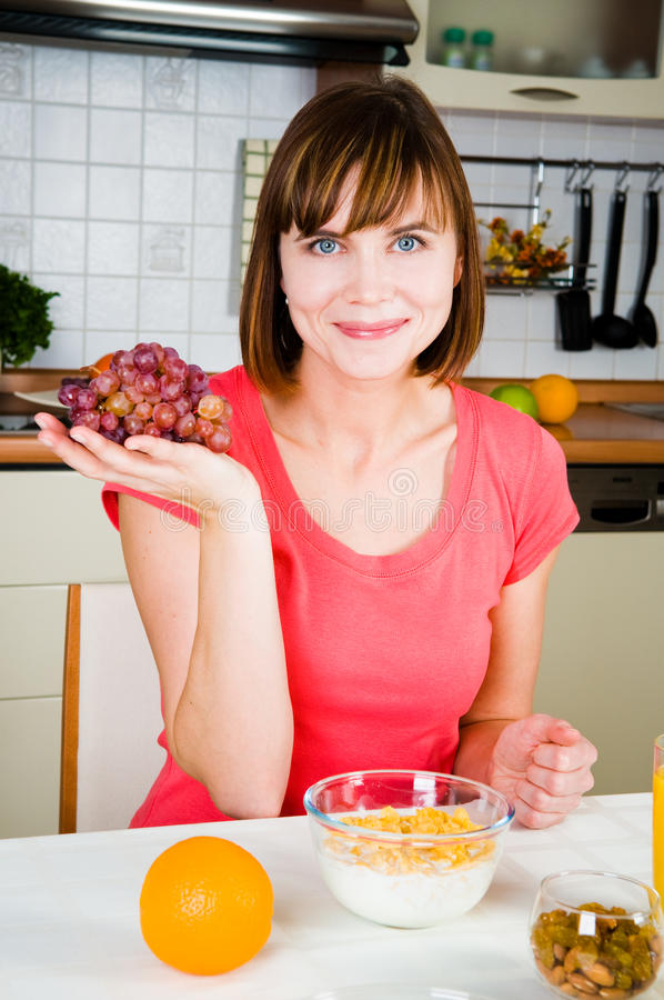 Download Young woman with grapes stock photo. Image of hair, girl - 14063954