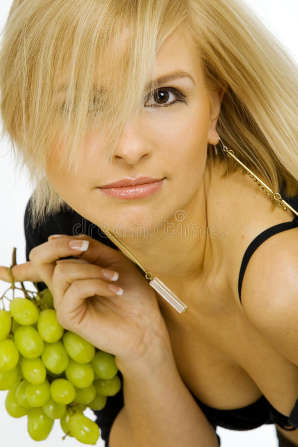 Young woman with grapes stock photo