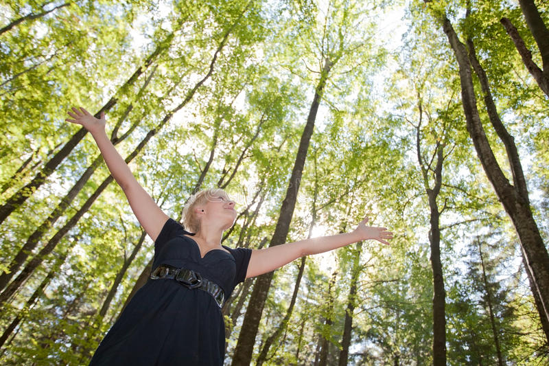 Young Woman  In Green Forest Stock Images