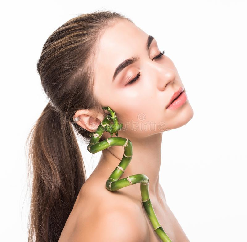 Young woman with green leaf, isolated on white. Beauty natural make up. Spa and wellness and skin care concept. Close up, selectiv. Young woman with green leaf stock images