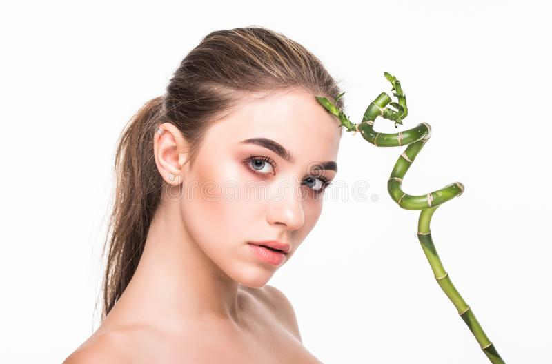 Young woman with green leaf, isolated on white. Beauty natural make up. Spa and wellness and skin care concept. Close up, selectiv. Young woman with green leaf royalty free stock photos