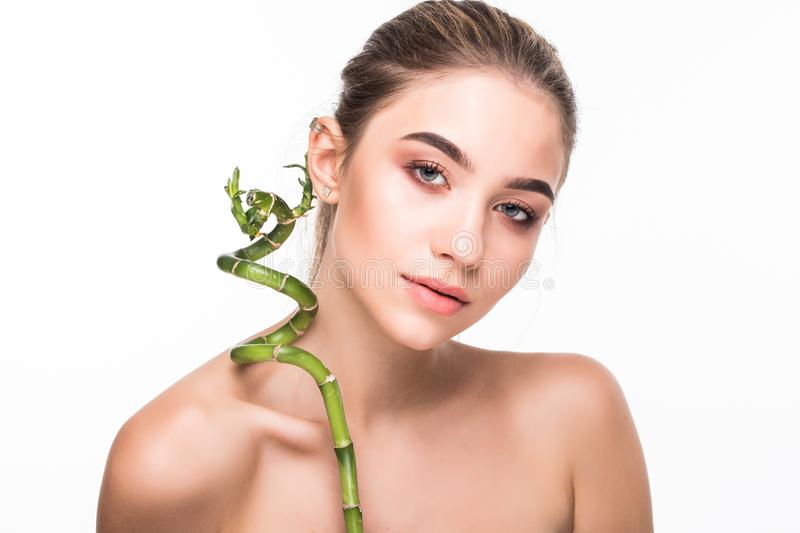 Young woman with green leaf, isolated on white. Beauty natural make up. Spa and wellness and skin care concept. Close up, selectiv. Young woman with green leaf stock image