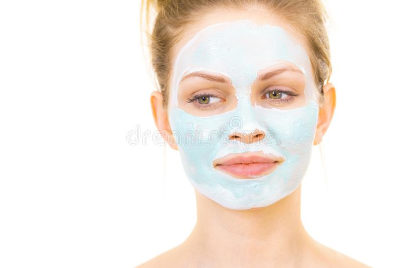 Girl with green mud mask on face stock images