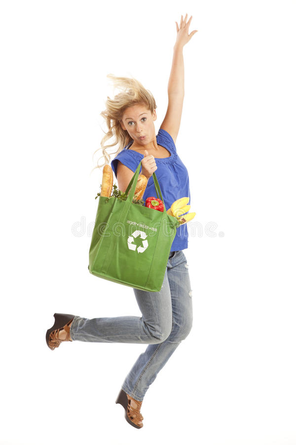 Young Woman With Green Recycled Grocery Bag Royalty Free Stock Image