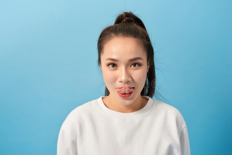 A young woman grimaces at the camera. Funny woman fooling around royalty free stock photos