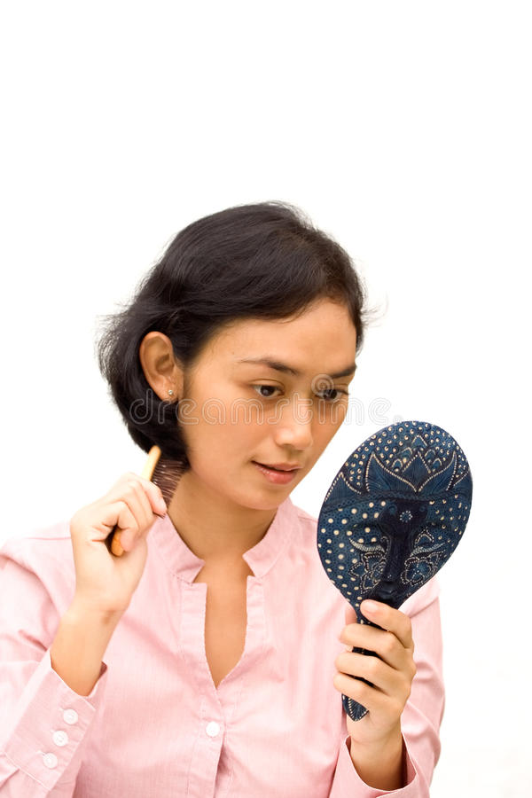 Young woman grooming stock images