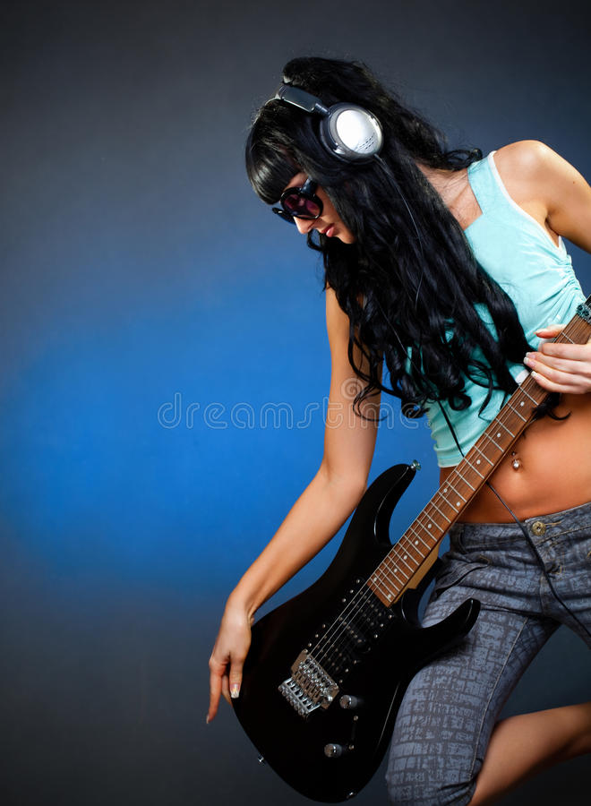 Young woman with guitar royalty free stock photo