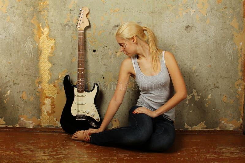 Young woman with guitar stock photos