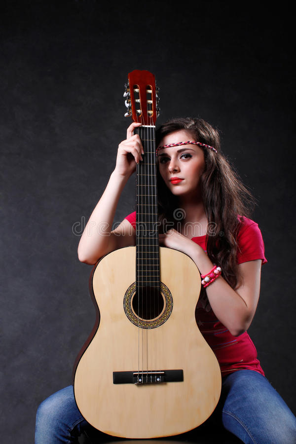 Young woman with guitar royalty free stock photos