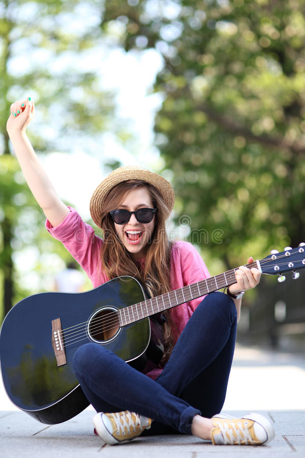 Download Young woman with guitar stock image. Image of acoustic - 24916291