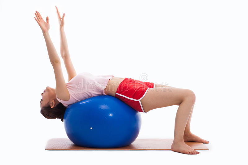 Young Woman With Gym Ball Isolated On White Stock Photography