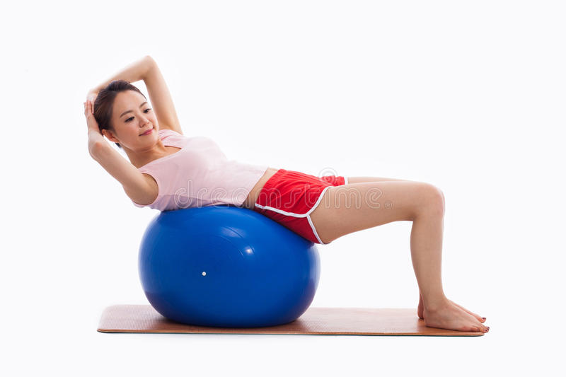 Download Young Woman With Gym Ball Isolated On White Stock Photo - Image: 29432622