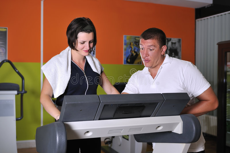 Download Young Woman In Gym With Coach Stock Photo - Image: 7079120