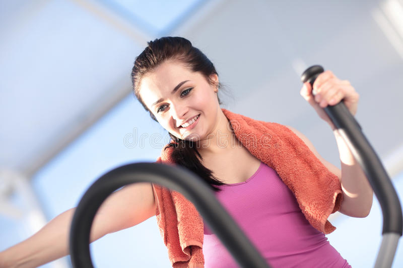 Young woman in gym doing exercises stock photo