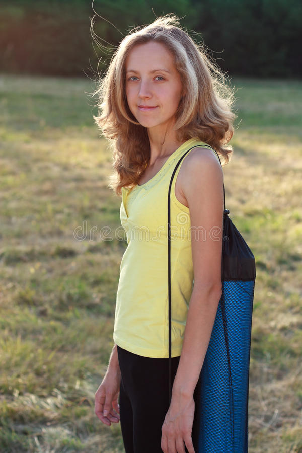 Download Young Woman With Gym Mat In The Nature Stock Photo - Image: 25656892