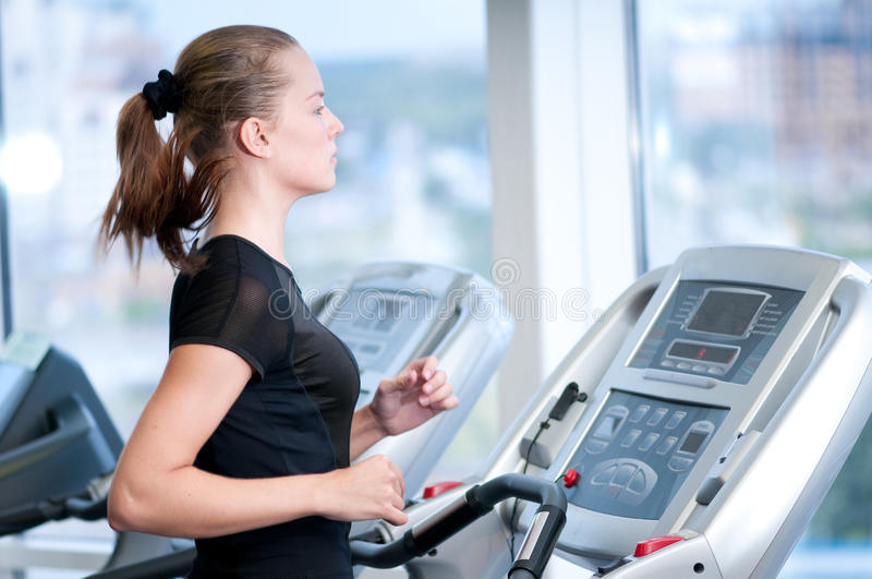 Download Young Woman At The Gym. Run On A Machine Stock Image - Image: 17726159