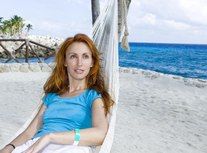 Download Young Woman In Hammock On Background Of Palm Trees Stock Photo - Image: 14224774