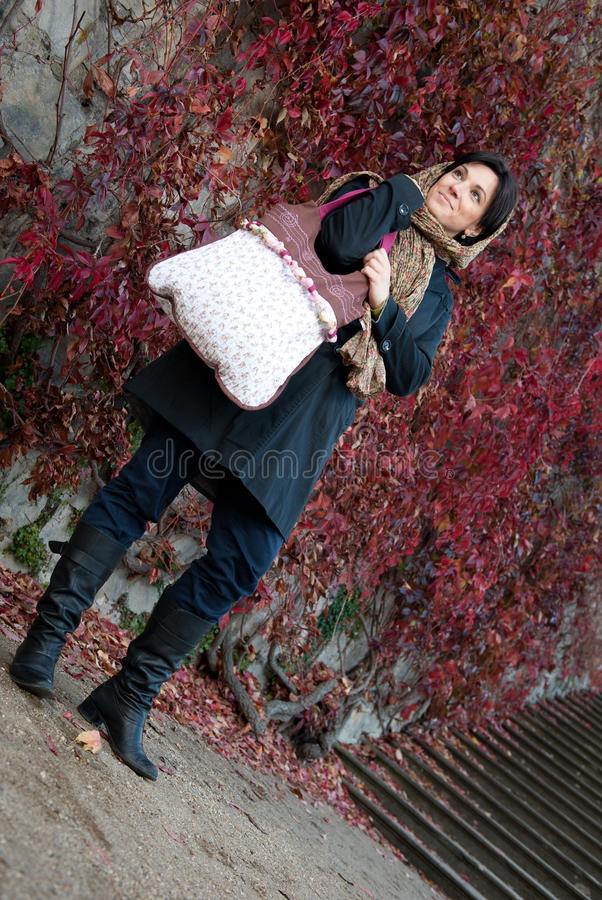 Young woman with hand bag stock photo