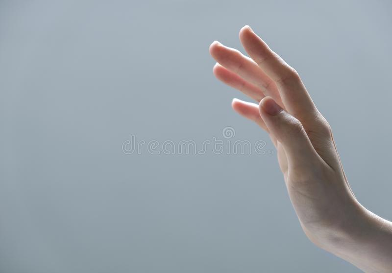 Young woman hand reaching out for touch something stock photos