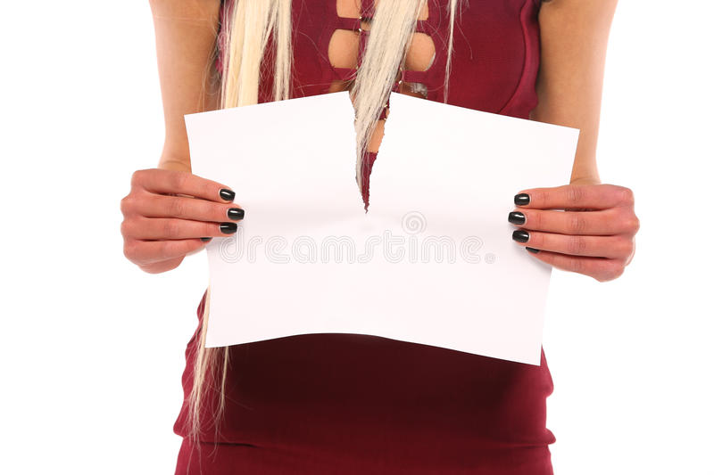 Young woman hand tear paper royalty free stock image